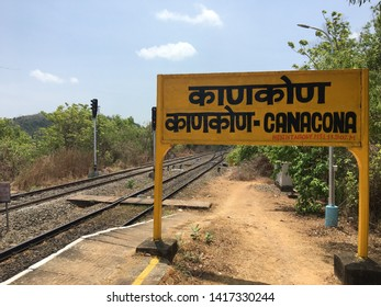 Goa / India - May 30 2019: Sign for the train station in Canacona, south Goa, on a hot summer day.