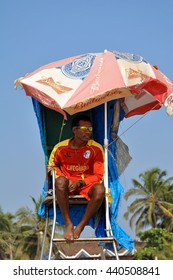 GOA,INDIA - March 13,2013:Male lifeguard sitting in the booth at the Baga beach in North Goa