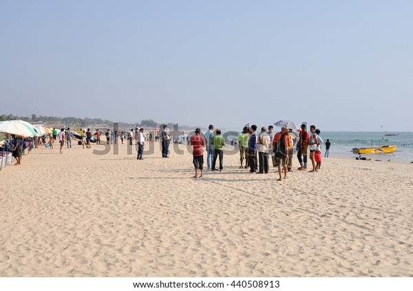 GOA,INDIA - March 13,2013:People tourists at the Baga beach in North Goa