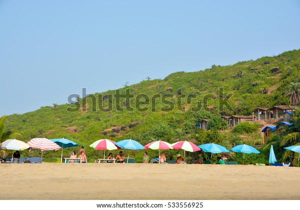 GOA,INDIA - NOVEMBER 12,2016:Tourists rest on the beach of Arambol.