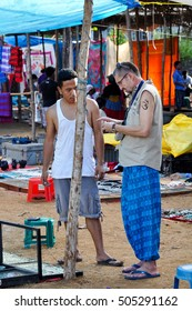 GOA,INDIA -NOVEMBER 2,2011:Sellers and buyers in the day market in Anjuna