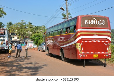 GOA,INDIA - NOVEMBER 9,2016: Tourist bus and people on the street in North Goa in Arpora