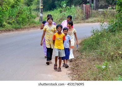 GOA,INDIA - OCTOBER 25,2011:Children walking in the street in the village of Anjuna