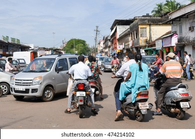 GOA,INDIA -OCTOBER 31,2011:Indians on motorcycles on the streets in Mapusa