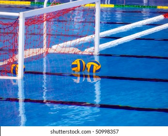 Goal and balls in the pool before the waterpolo game.