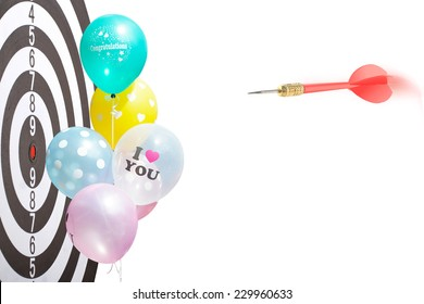 The goal of business is intended to accomplish as a team darts on dark gray background with arrows, middle target balloon colorful wrote congratulations and print words I love you. isolated on white.