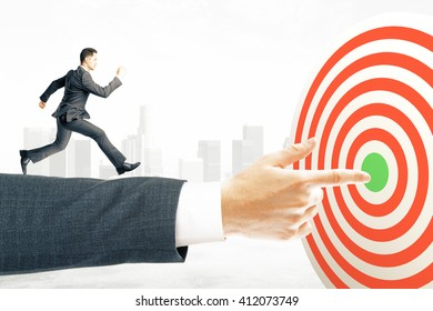 Goal concept with businessman miniature running towards target board