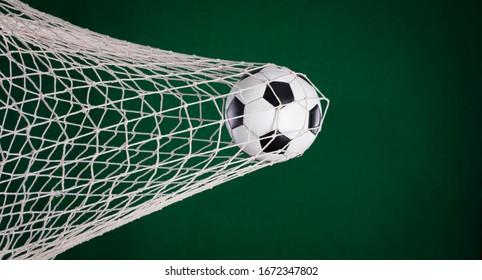 goal net, soccer ball in goal, green background