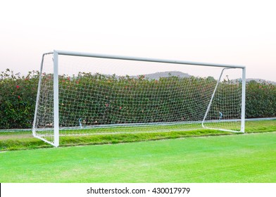 Goal shot from the corner in the front ,soccer field,empty amateur football goal posts and nets