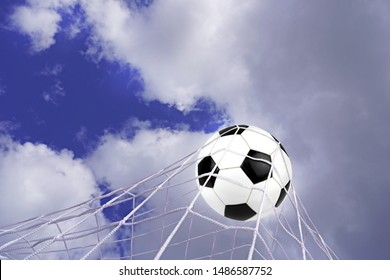 Goal. Soccer ball in net with sky background.