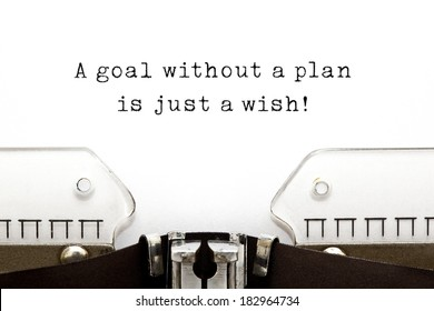 A goal without a plan is just a wish! quote printed on an old typewriter.