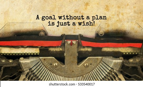 A goal without a plan is just a wish! typed words on a vintage typewriter with vintage background