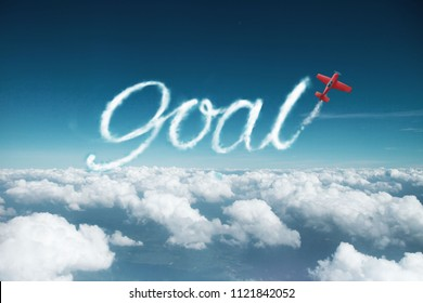 GOAL word created from a trail of smoke by Acrobatic plane.