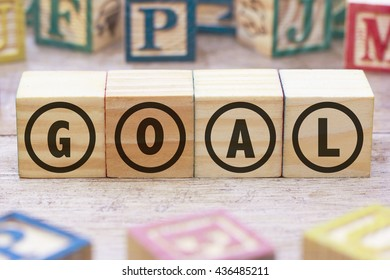 Goal word written on wood cube