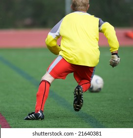 Goalie chasing after soccer ball