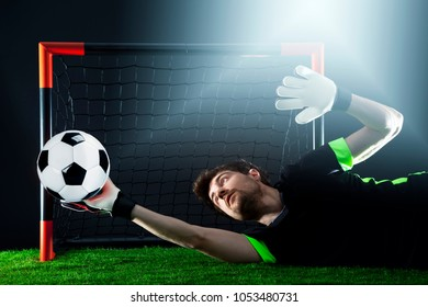 Goalkeeper defending goal. Soccer