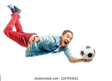 Goalkeeper flying for the ball isolated on white