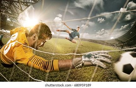Goalkeeper in gates jumping to catching ball