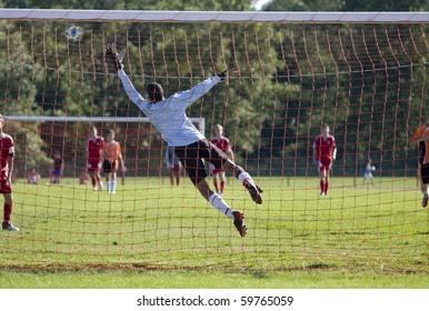 Goalkeeper jumping during a soccer mach