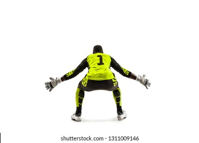 Goalkeeper ready to save on white studio background. Soccer football concept. Back view