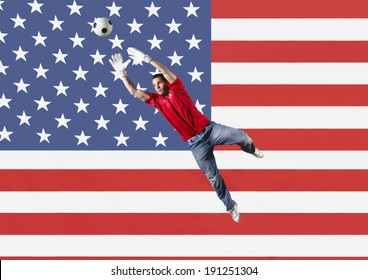Goalkeeper saving ball in front of US flag