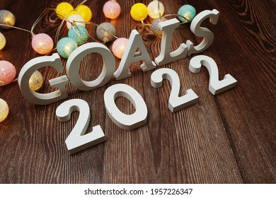 Goals for 2022 alphabet letter with LED cotton balls on wooden background
