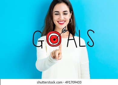Goals concept with young woman on blue background