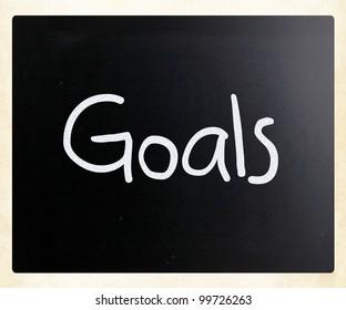 """""""Goals"""" handwritten with white chalk on a blackboard"""