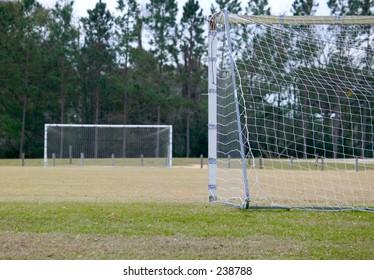 goals on an empty soccer field