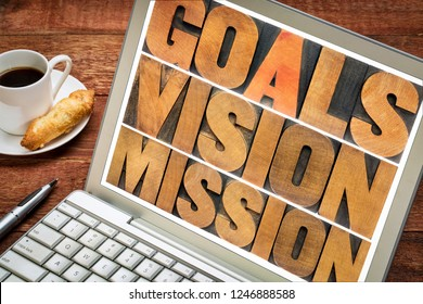 goals, vision, mission concept  - word abstract in vintage letterpress wood type on a laptop screen with a cup of coffee
