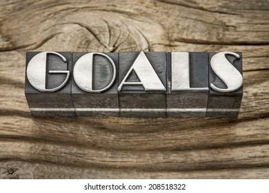 goals word in letterpress metal type printing blocks against weathered grained wood