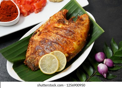 Goan fish fry or Kalundar grilled, hot and  spicy dish Goa India. Pearl spot fish marinated with  ingridients, Indian spices deep fried in coconut oil for the preparation of red fish curry.