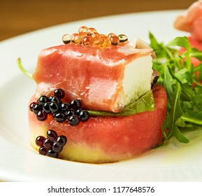 Goat feta cheese cubes rolled in proschiutto ham served on watermelon and garnished with caviar and rucola