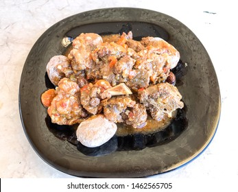 goat meat with wrinkled potatoes