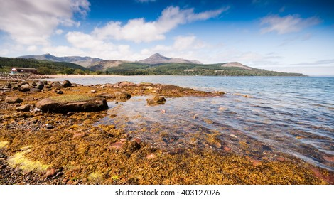 Goatfell mountain provides the backdrop for Brodick Bay on the Isle of Arran in Scotland.