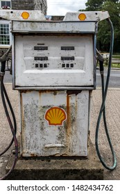 Goathland / Great Britain - July 14, 2019 : Old decayed rusting petrol gas pump with Shell Petrolium branding and signs.