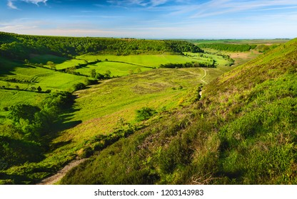 Goathland, Yorkshire, UK. Hole of Horcum in the North York Moors with view of farmland, moorland, and vegetation on a fine spring/summer morning near Goathland, Yorkshire, UK.