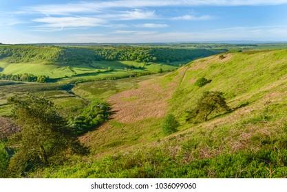 Goathland, Yorkshire, UK. Sunrise over the North York Moors overlooking Hole of Horcum on a fine spring morning near Goathland, Yorkshire, UK.