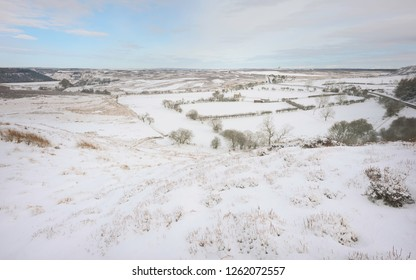 Goathland, Yorkshire, UK. View across the beautiful North York Moors covered in snow on a bright morning in winter, Goathland, Yorkshire, UK.