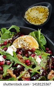 Goat's Cheese Salad with Arugula, Dates, Oranges, Walnuts and Zaatar Dressing