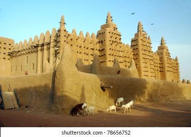 Goats and sheep walking past the Djenne mud mosque in Mali