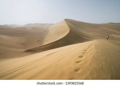 Gobi Desert, China - 08 07 2016 : Hike in the Gobi desert. Sand dunes with footprint in the Gobi Desert in China