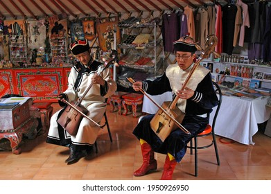 GOBI DESERT, MONGOLIA - 2006: Mongolian musicians in traditional costume play morin khuurs the popular instrument, played during,rituals, celebrations, and as an accompaniment for dances or songs.