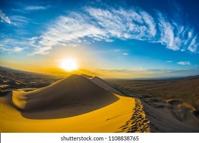 Gobi Desert, Mongolia- July 13 2017: Beautiful landscape of a sand dune with blue sky at sunset in the Gobi desert, Mongolia.