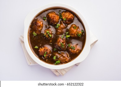 Gobi Manchurian dry - Popular street food of India made of cauliflower florets, selective focus