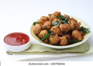 gobi pakoda/gobi dry manchurian/street food of india   cauliflower served in ceramic bowl