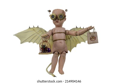Goblin steam punk creepy doll with Da Vinci bat wings and aviator goggles trick or treat candy bag with little monsters in cage standing isolated on white