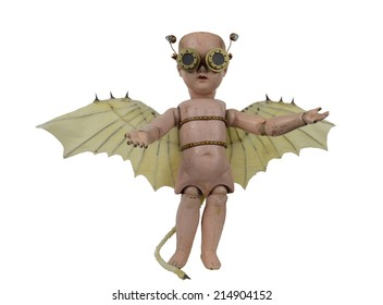 Goblin steam punk creepy doll with Da Vinci bat wings and aviator goggles standing isolated on white