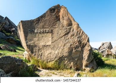 Gobustan, Azerbaijan - May 1, 2019. Stone marking entrance to Gobustan national park in Azerbaijan.