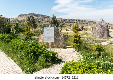 Gobustan, Azerbaijan - May 1, 2019. Landscape at the entrance to Gobustan Museum in Azerbaijan, with sign.